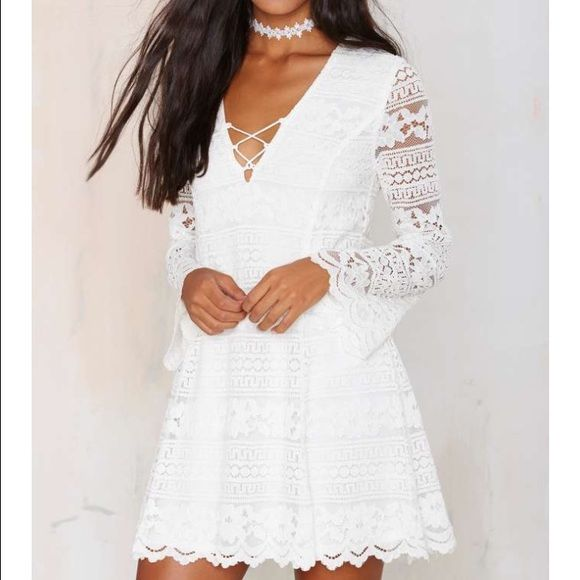 #222 nasty gal We heart you, so we just had to bring you this white lace stunner. The Crossed Hearts Dress features a lattice design at neckline, flared sleeves, asymmetric hems, and zip/hook closures at back. Partially lined. Perfect with platforms, circle shades, and a wide-brim hat!  *Cotton/Nylon/Polyester  *Runs true to size  *Model is wearing size small  *Hand wash cold  *Imported Nasty Gal Dresses Long Sleeve