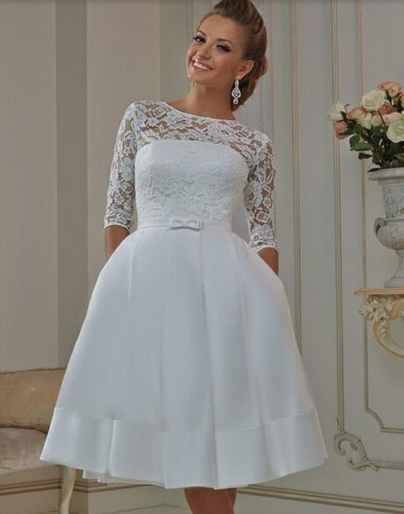 This illusion neckline wedding dress has a vintage feel. If you are ...