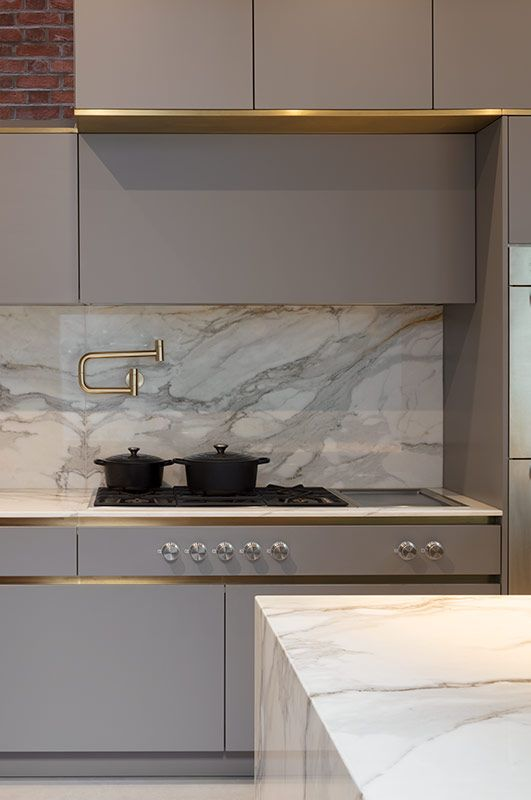 Govotsis: A matt lacquer kitchen with brass cladding from Roundhouse Design #kitchensplashbacks