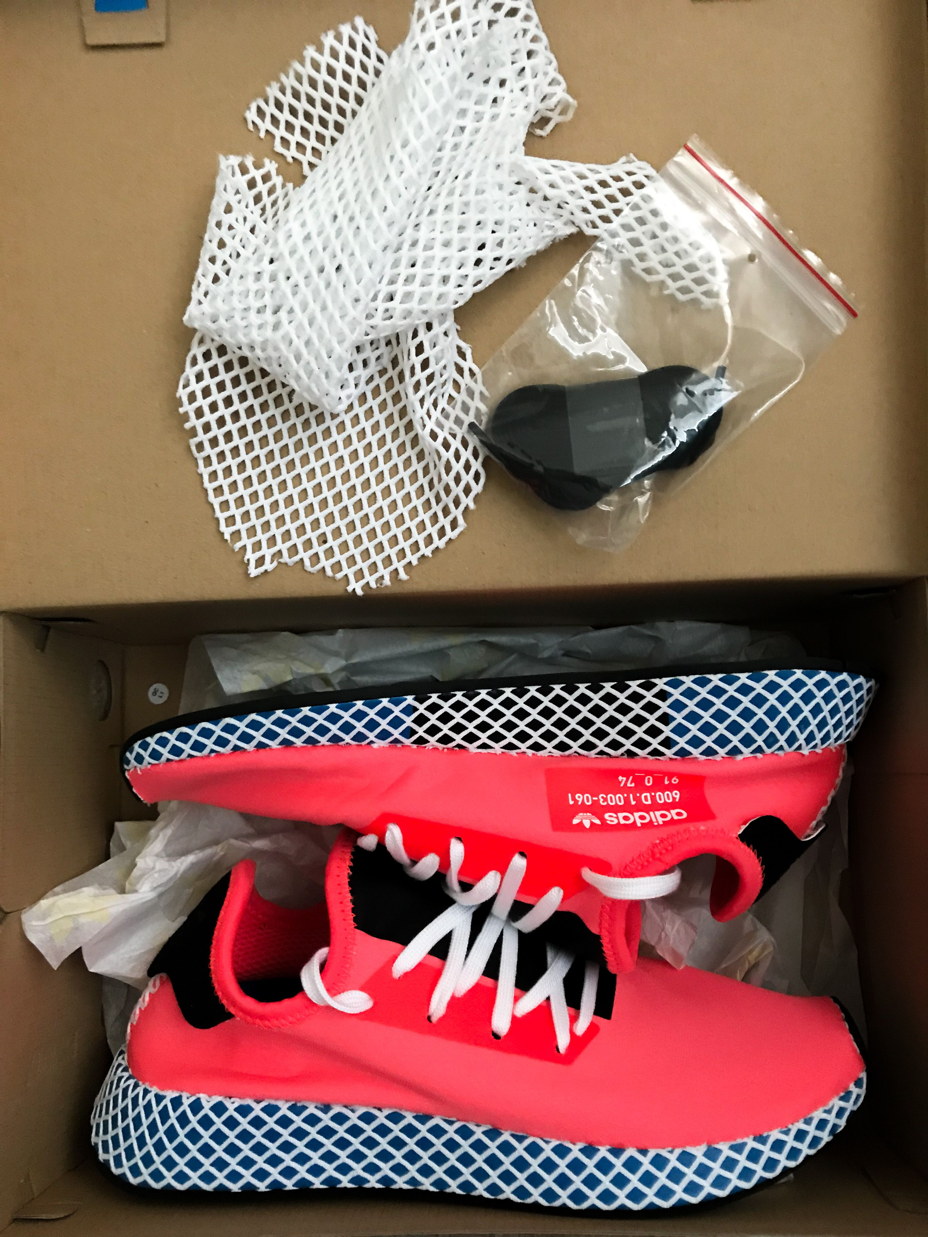reputable site 59b00 128d0 Uncaged Adidas Deerupt Runner sneakers