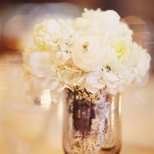 Small white arrangements that will run along the dining table
