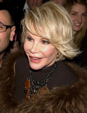 Joan Rivers photographed leaving party covered in cake as part of stunt | TheCelebrityCafe.com
