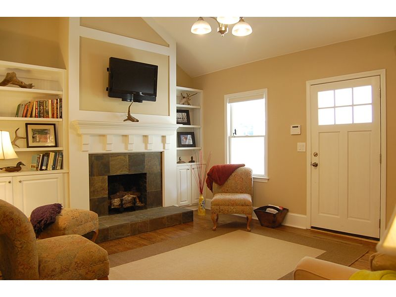 Off Center Fireplace With Vaulted Ceiling