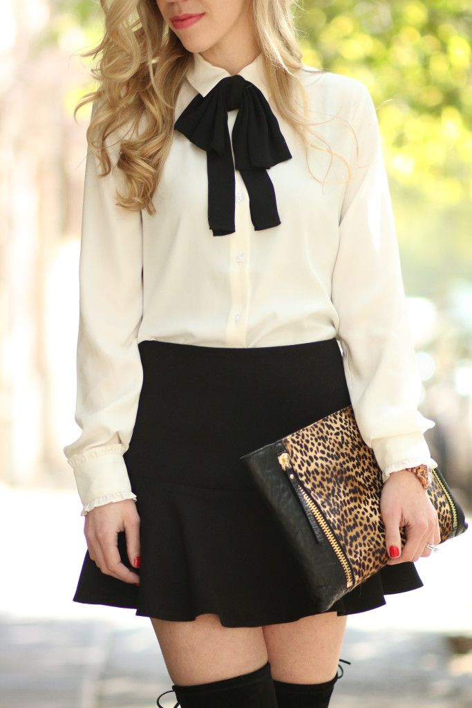 Ann Taylor cream blouse with black bow tie, Forever 21 black flounce mini skirt, oversized leopard clutch, Stuart Weitzman Highland black suede thigh high boots, Chanel rouge lipstick Edith, pink lip, classic black and white