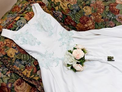 My old wedding dress.We used bead embellishments and Gilders Paste to give an old wedding dress new life.