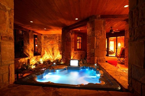 Indoor Hot Tub With Fireplace Tv In A Room With A Door