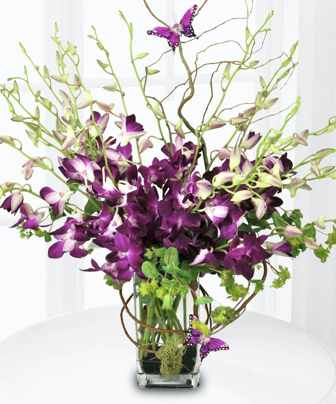 Tropical Twist In 2020 Orchid Flower Arrangements Purple Orchids Amazing Flowers
