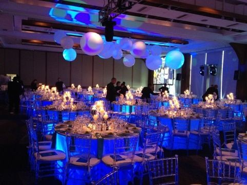 Blue Uplights Underneath Table Linens