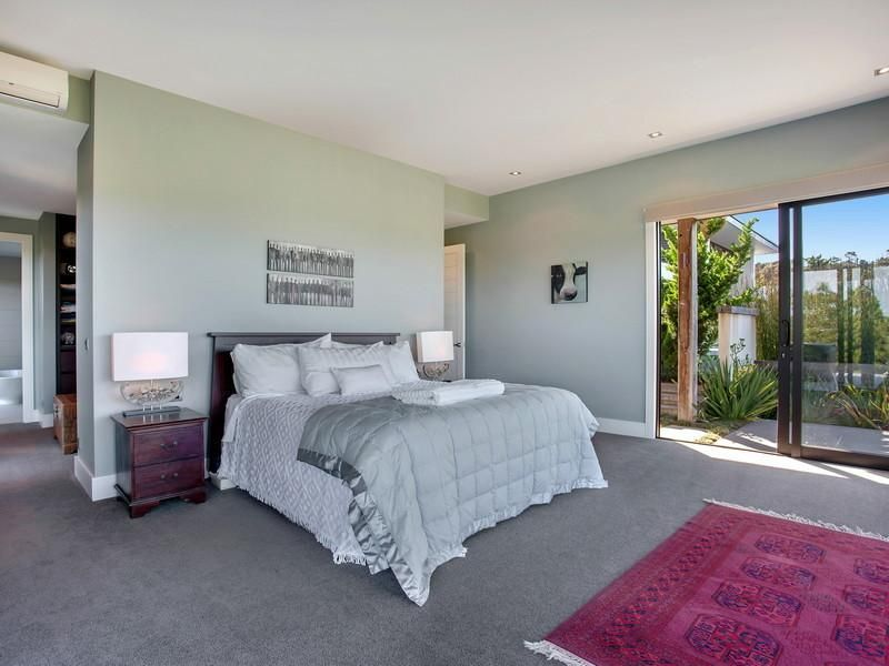 Contemporary Hill Home With Beautiful Gardens And Pool : Gray Carpet Design  As Bedroom Interior Decorated
