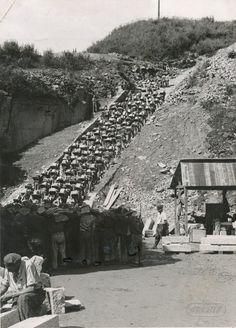 Prisoners transporting stones at Mauthausen-Gusen concentration camp, which was the hub of a large group of German concentration camps that was built around the villages of Mauthausen and Sankt Georgen an der Gusen in Upper Austria, roughly 20 kilometres east of the city of Linz.