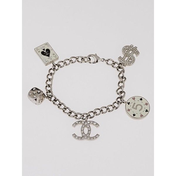 Pre Owned Chanel Silvertone Las Vegas Charm Bracelet 375 Liked On