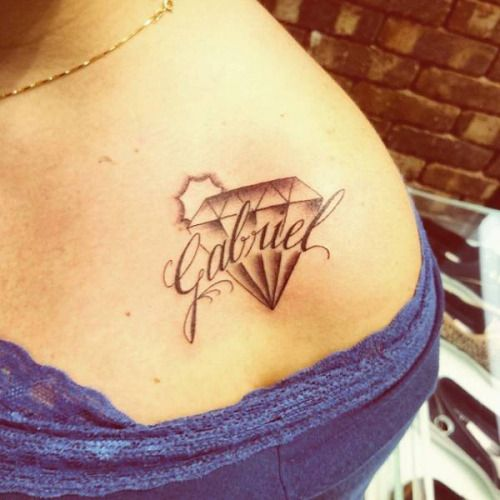 Little Shoulder Tattoo Of A Diamond Together With The Name