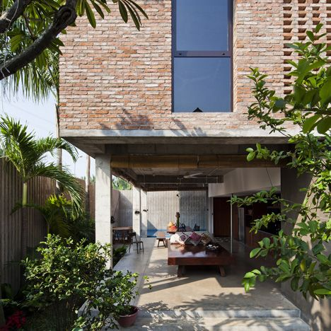Vietnam house by MM++ Architects features a palm-leaf roof and an ...