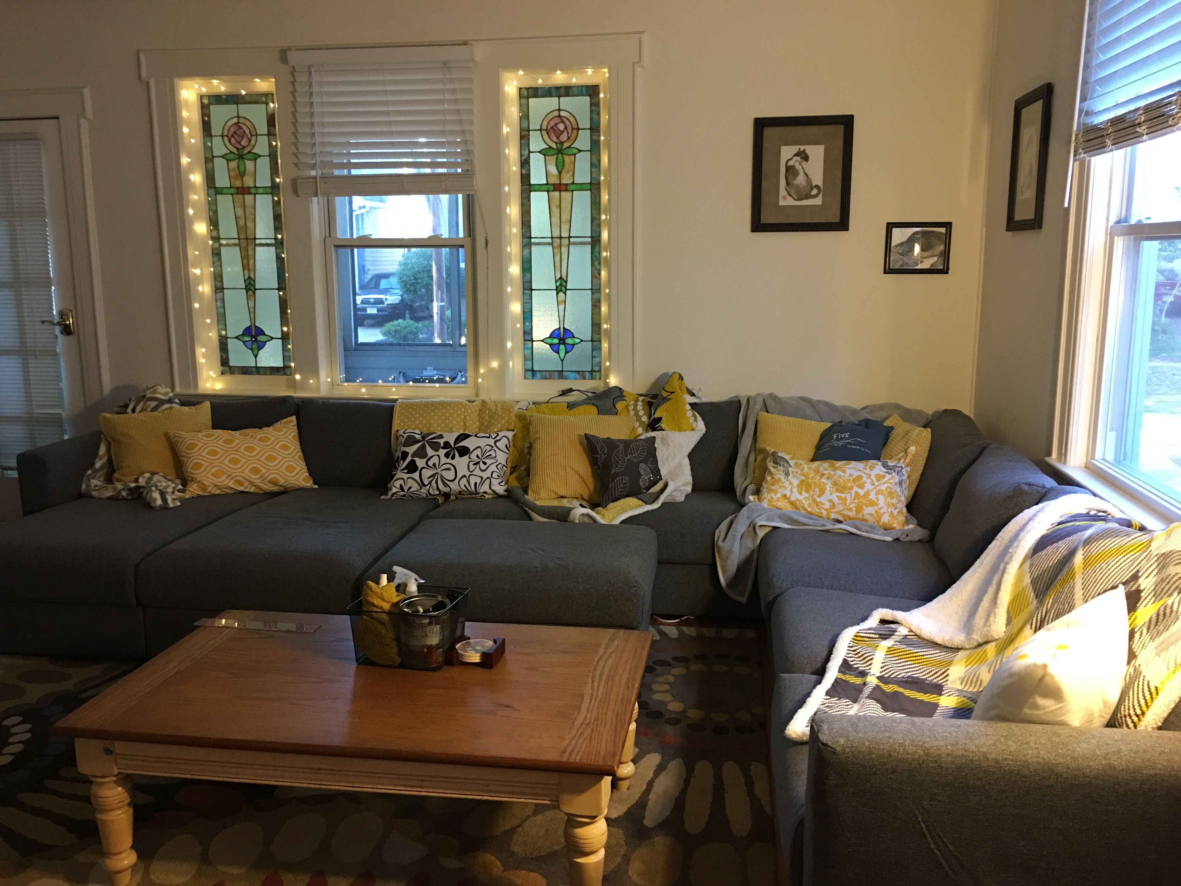 grey and yellow living room with fairy lights around