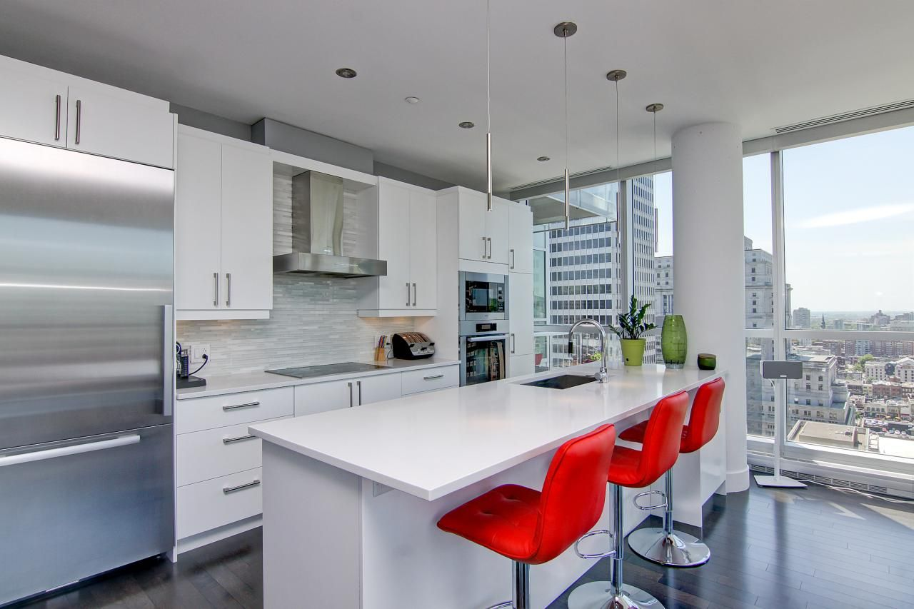 This lush kitchen design embraces simple white materials and