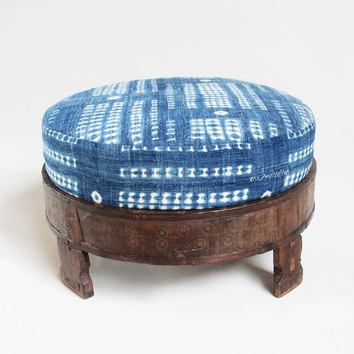 Original African indigo mud cloth ottoman cushion seated in a hand ...