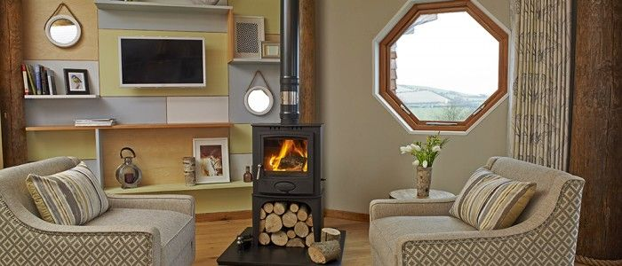 Treberfedd Farm, Ceredigion. Our beautiful little houses in the meadow, unique octagonal shaped design, with turf roofs to keep you warm in the winter and cool in the summer http://www.organicholidays.com/at/3374.htm
