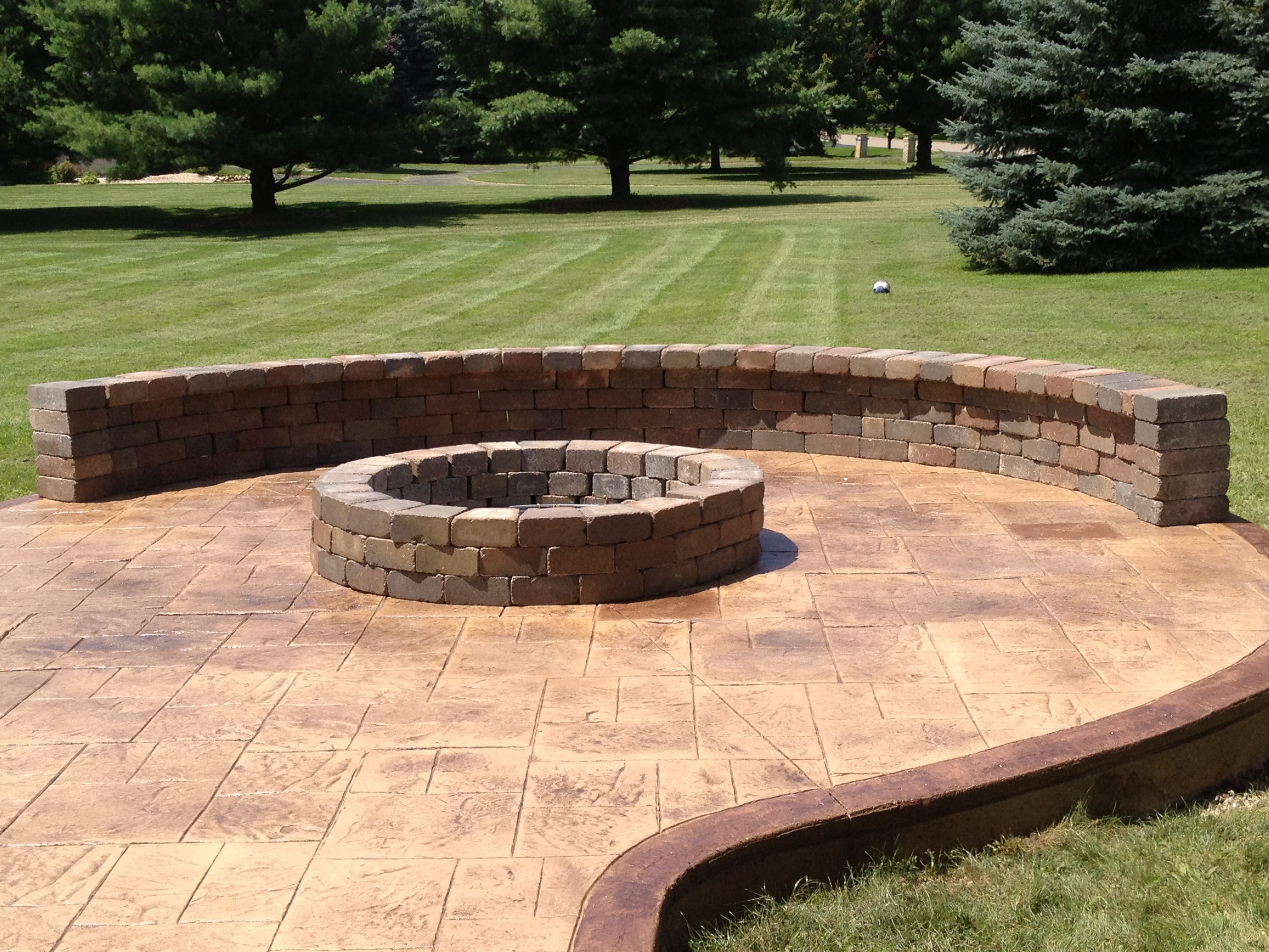 Stamped concrete patio with fire pit and sitting wall for Concrete fire pit plans