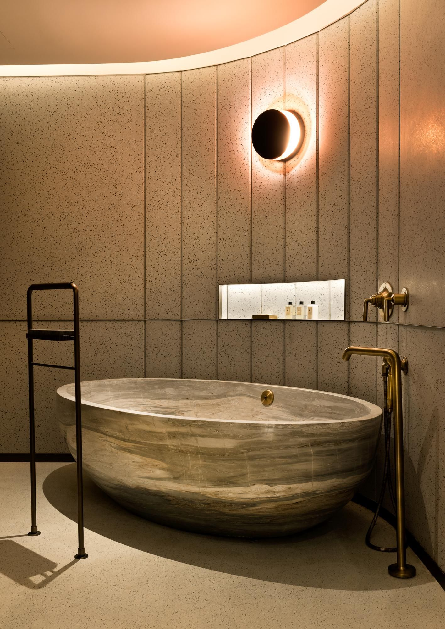 The suite\'s master bathroom has been built around a freestanding one ...