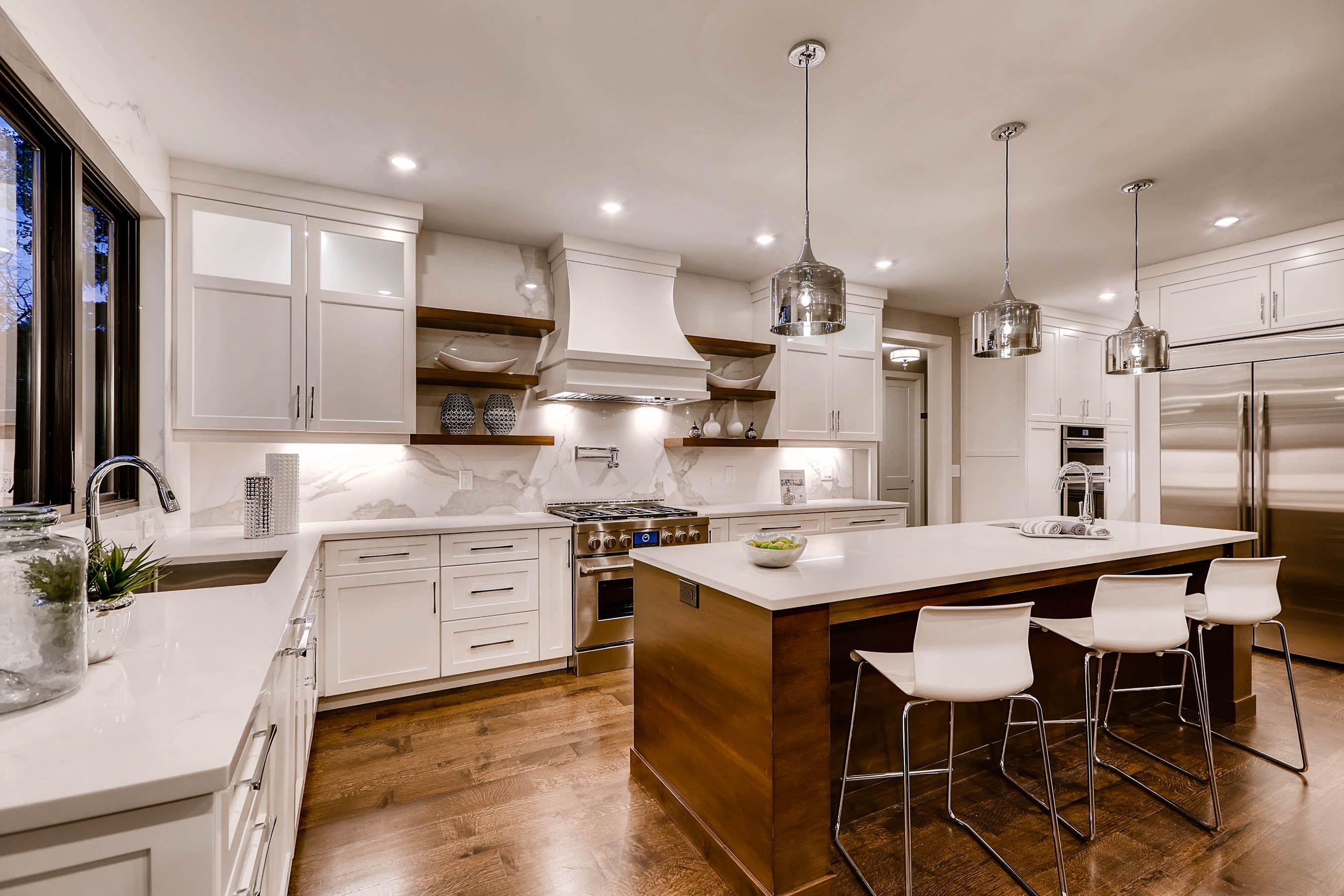 Custom white kitchen with wood floors in this six-bedroom $1.6 million home in Colorado [OS] [2700 X 1800]