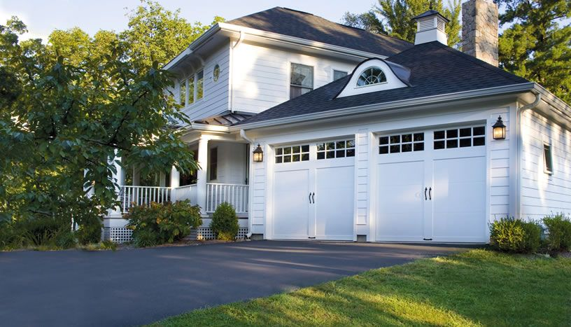 Clopay Coachman Portfolio Residential Garage Door Design 11 Carriage House Doors Garage Door Styles Garage Doors