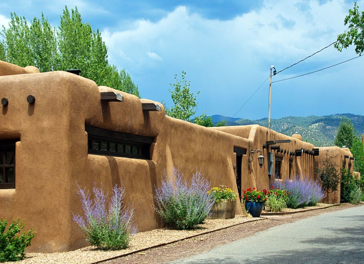 13 Striking House Styles From Around The World Pueblo Style House Revival Architecture Pueblo House