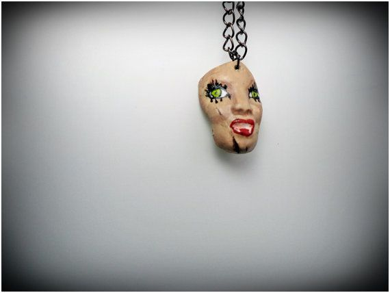 Check out this item in my Etsy shop https://www.etsy.com/listing/243466948/vampire-doll-face-handmade-necklace