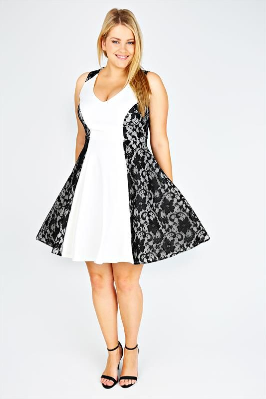 White dress with black lace side panels
