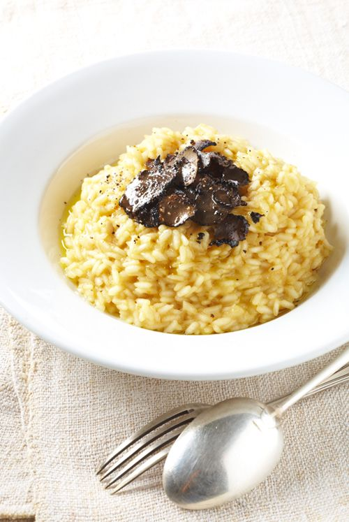 This decadent risotto recipe is a specialty from Piedmont, Italy.  The intoxicating aroma of the white truffle oil is irresistible!  Perfect as a first or main course. #oliviersandco #risotto #irresistible #recipe