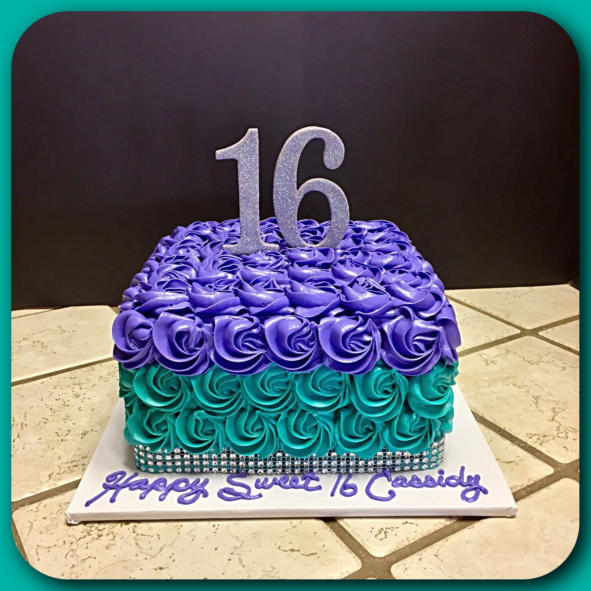 A Rosette Cake In Purple And Turquoise