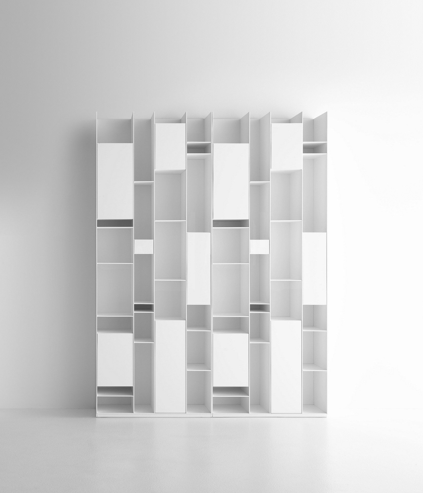 A Bookcase With Compartments Closed By Doors Made Of Medium Density