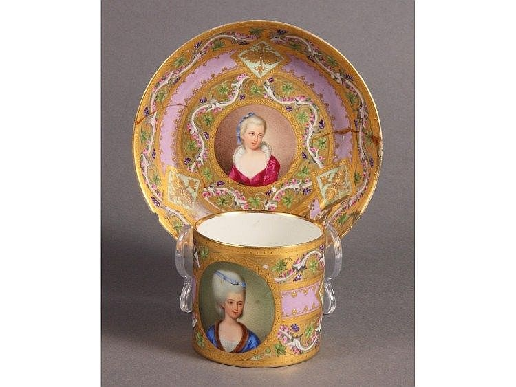 An early 19th Century Vienna porcelain coffee can and saucer dish with reserved portrait panels on a gold and enamelled ground and a Meissen design chocolate cup and cover with reserved panels of coastal scenes (saucers extensively restored)