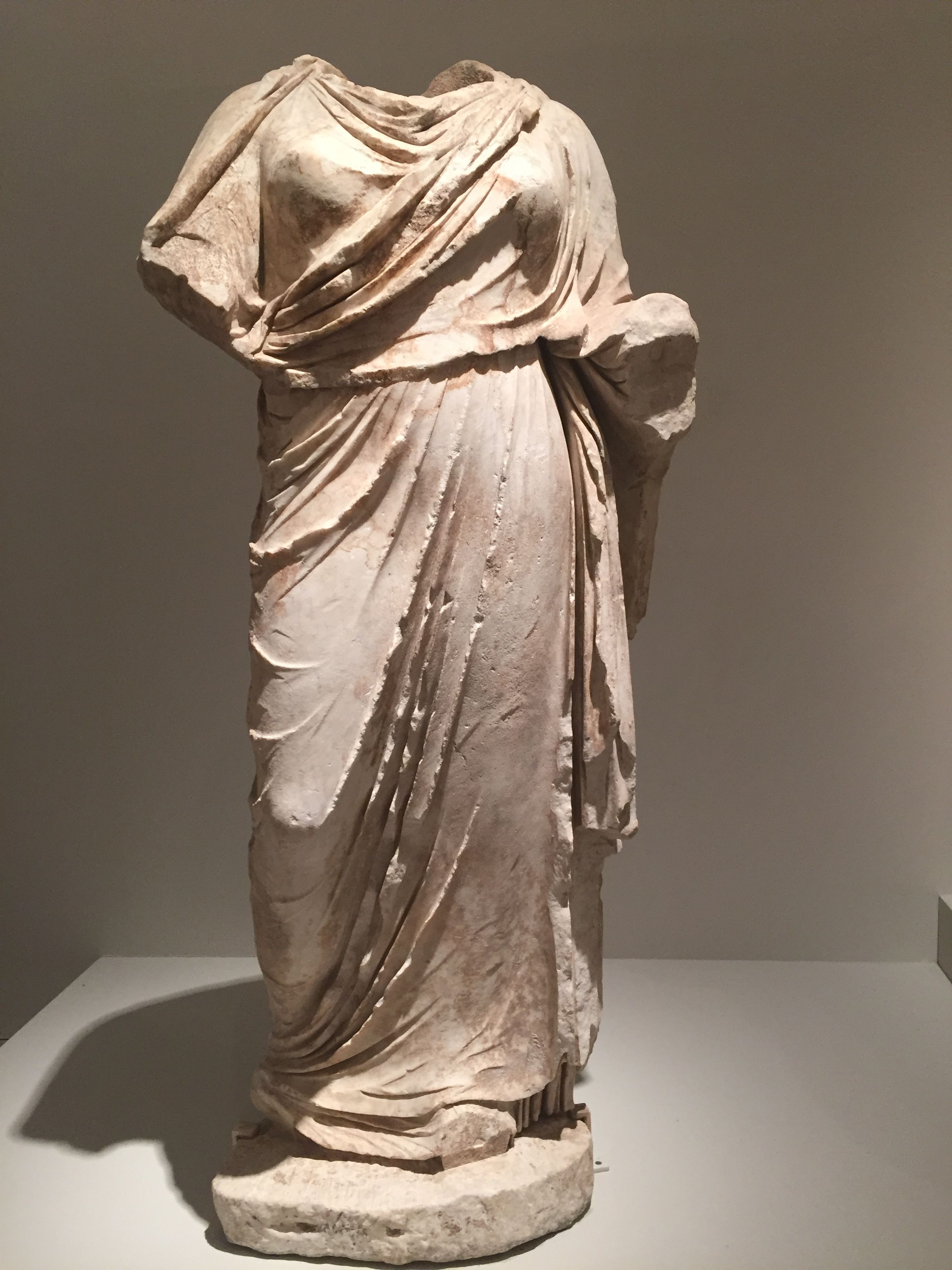 Marble draped female figure, Early Hellenistic Greek, end of the 4th century BC, Metropolitan Museum of Art
