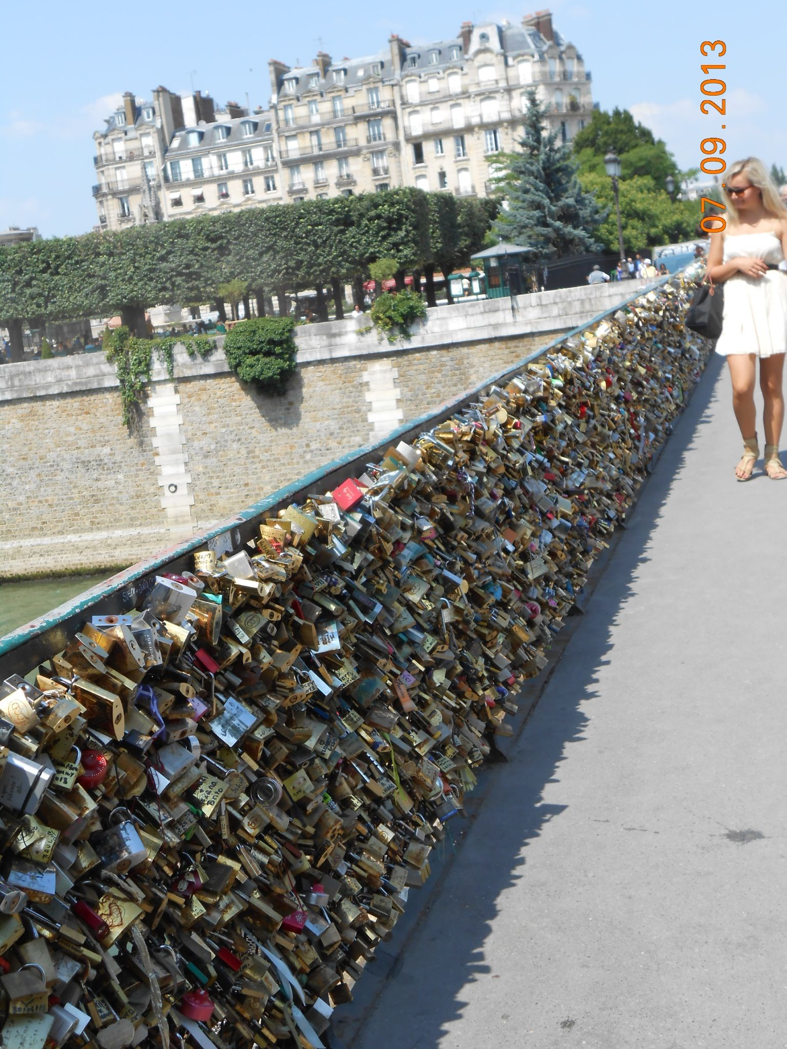 To put a lock on the locks of love bridge in paris france for The lock bridge in paris