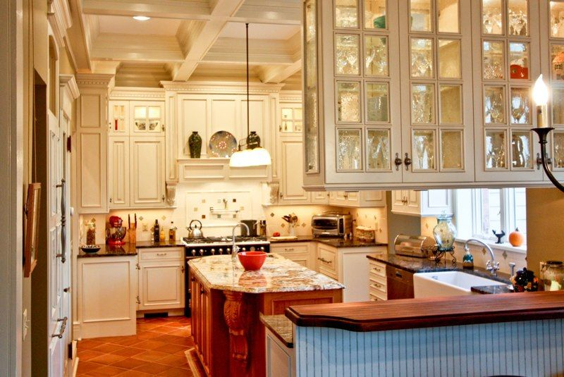Glass Doors On Both Sides Of Pennisula Cabinets Kitchen Cabinet Colors Kitchen Remodel Inspiration Cream Colored Kitchen Cabinets