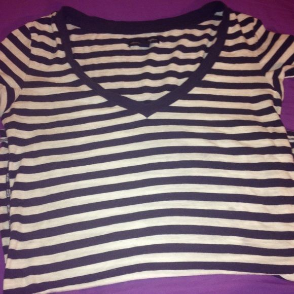 American eagle striped short sleeved top Great condition top just doesn't fit me. There are no stains, holes etc. I do have the shirt folded In half because it is long but when it is on it fits perfectly American Eagle Outfitters Tops