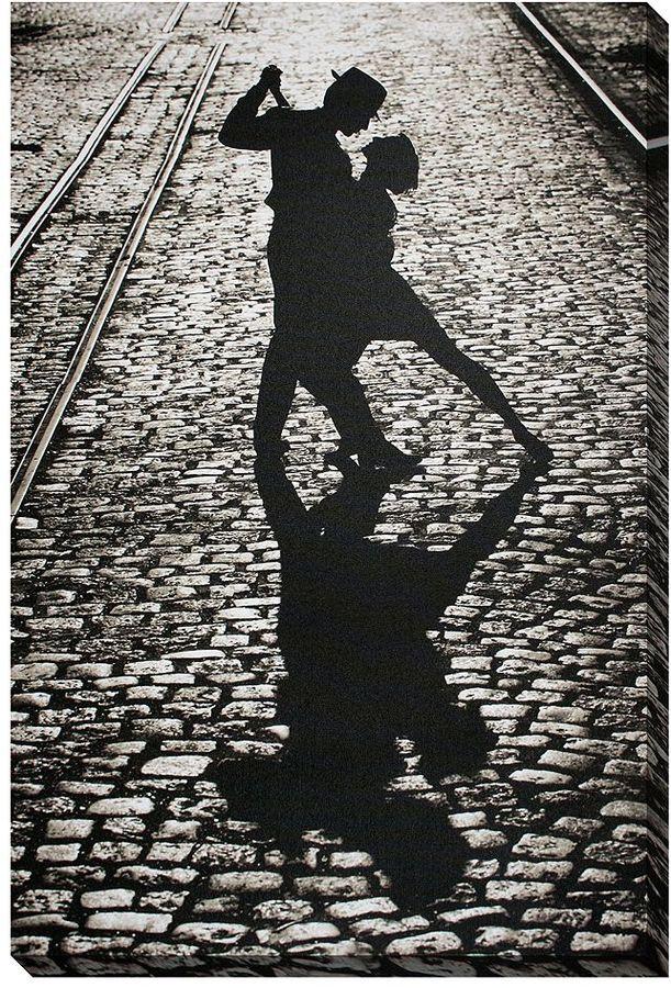 Featuring two people dancing on a cobblestone street, this canvas wall art delivers heartwarming and romantic style. <ul> <li>Black and white design lends retro appeal.</li> <li>Box frame rests on nails, making hanging easy. PRODUCT DETAILS</li> <li>36''H x 24''W x 2''D</li> <li>Vertical display</li> <li>Ready to hang</li> <li>Canvas, wood</li> <li>Model no. 10650
