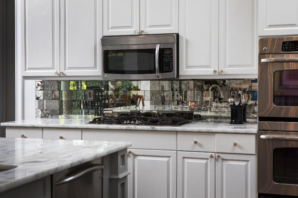 Beautiful white kitchen with antique mirror back splash ...