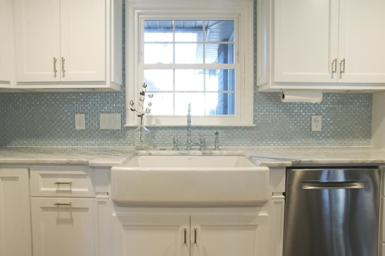 This beautiful kitchen design features our susan jablon 34 inch an elegant kitchen design with a curved milk glass tile backsplash dailygadgetfo Gallery