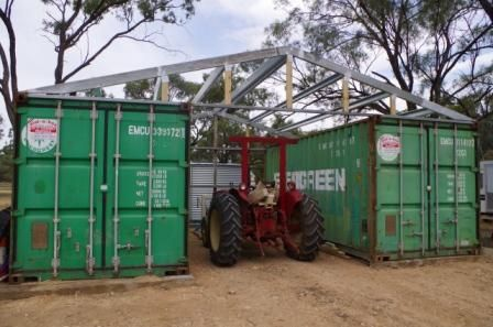 Shipping Container Shed Construction Tractor Parked In