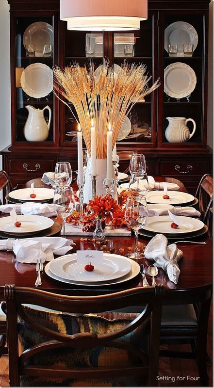 A Bountiful Harvest Thanksgiving Tablescape I love the large wheat sheaf centerpiece and pops of orange with the white dishes in this Thanksgiving tablescape! Bountiful Harvest Thanksgiving Tablescape I love the large wheat sheaf centerpiece and pops of orange with the white dishes in this Thanksgiving tablescape!I love the large wheat sheaf centerpiece and pops of orange with the white dishes in this Thanksgiving tablescape!