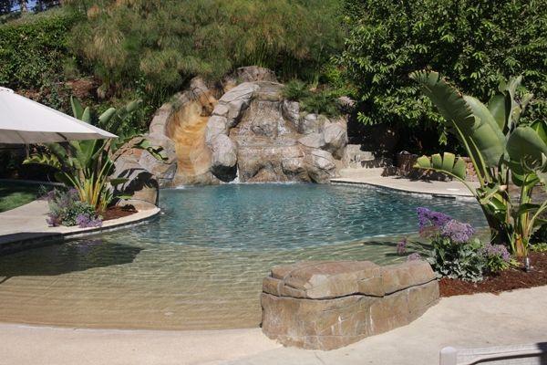 Beach Style Pool With Slide Backyard DesignsPool