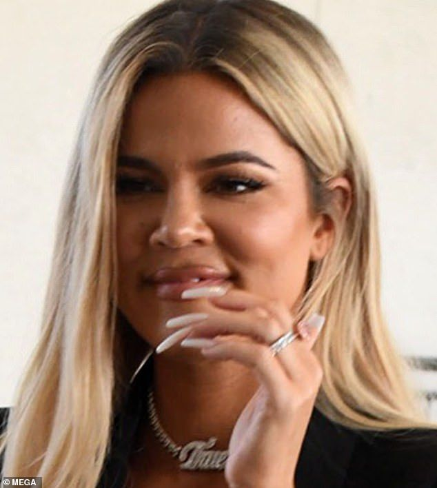 Khloe Kardashian sports VERY plump pout and sexy LBD at new Good American store #khloekardashian