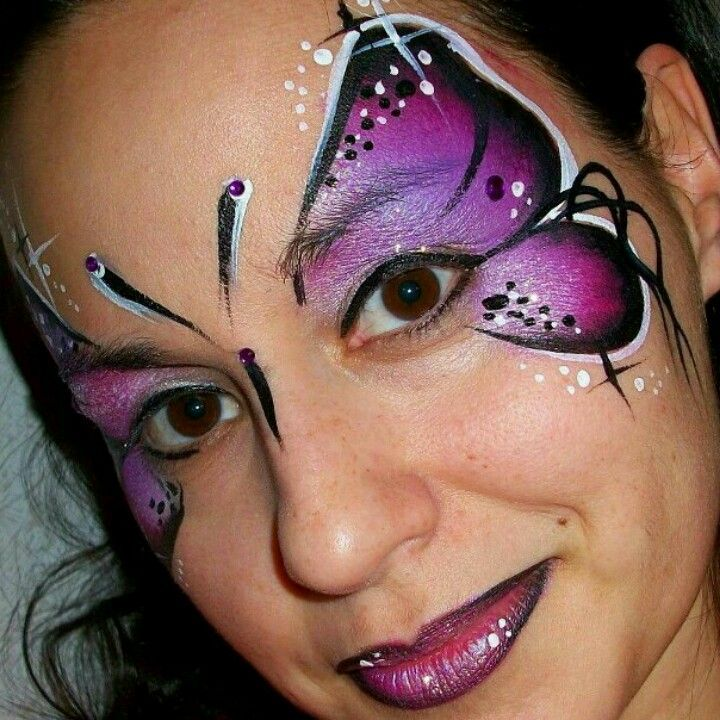 Purple butterfly face paint
