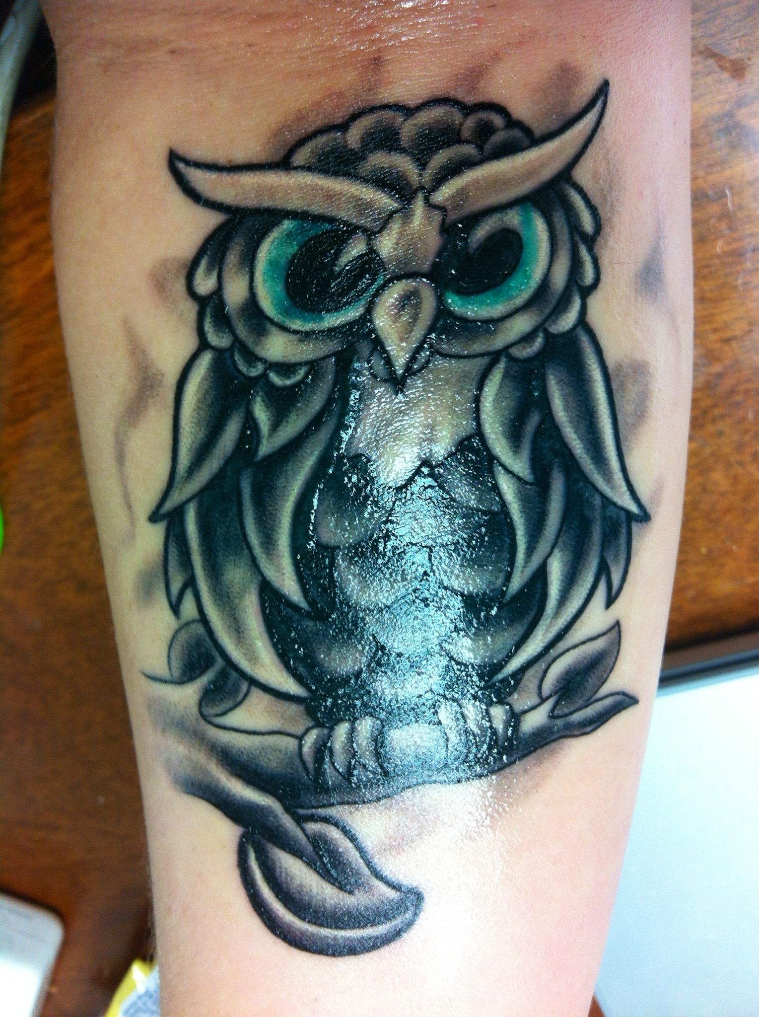 Owl tattoo. Black and Gray shades with teal eyes Tattoos