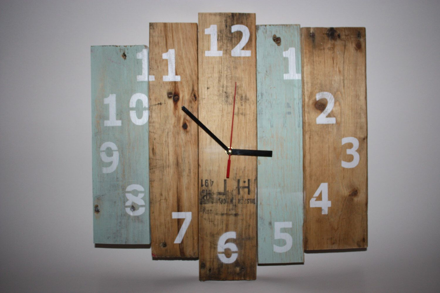 Rustic Wooden Clock, Recycled Pallet Clock, Recycled wooden wall clock, Reclaimed Wood Clock with numbers by HoskinsWoodWorking on Etsy https://www.etsy.com/listing/227126987/rustic-wooden-clock-recycled-pallet