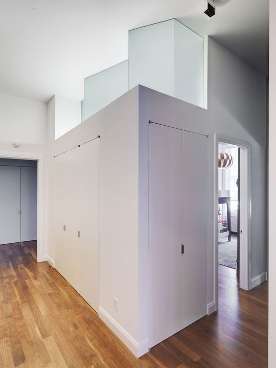 A Serrated Transom Window Above The Closet In The Children S Room Floods The Hallway With Natural Light By Movi Built In Furniture Family Apartment Apartment