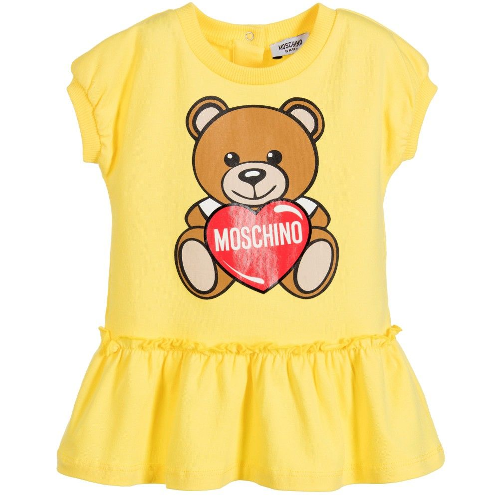 Girls Yellow Short Sleeved Dress By Moschino Baby Made In Soft Cotton Jersey It Has A Ruffle Trimmed Skirt Baby Girl Yellow Baby Fashion Fashion Girl Design