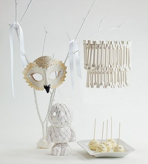 White is not a traditional color for Halloween décor but it looks so - unique halloween decor