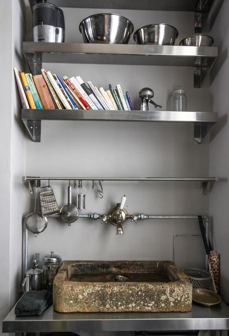 Stone sink and stainless steel counter top and shelves in regency